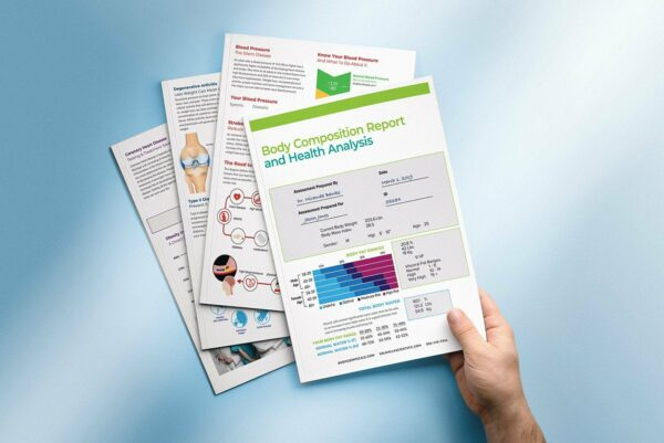 male hand holding five-page measurement results from the BodyCompScale BCS Elite